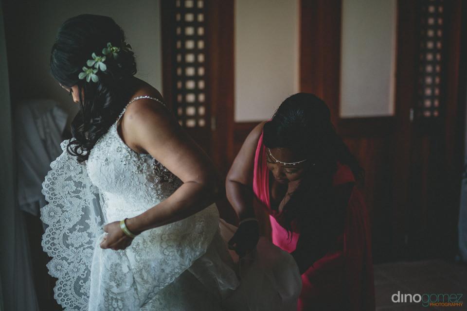 gorgeous bride in luxury white wedding dress at cabo wedding pho