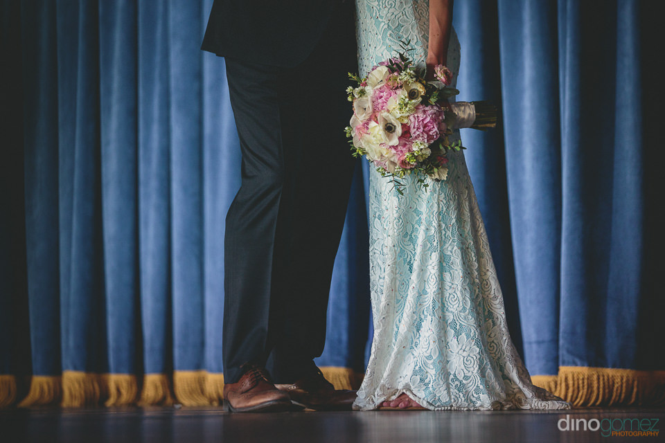 wedding photo of newlyweds lower body in suit and dress by dino