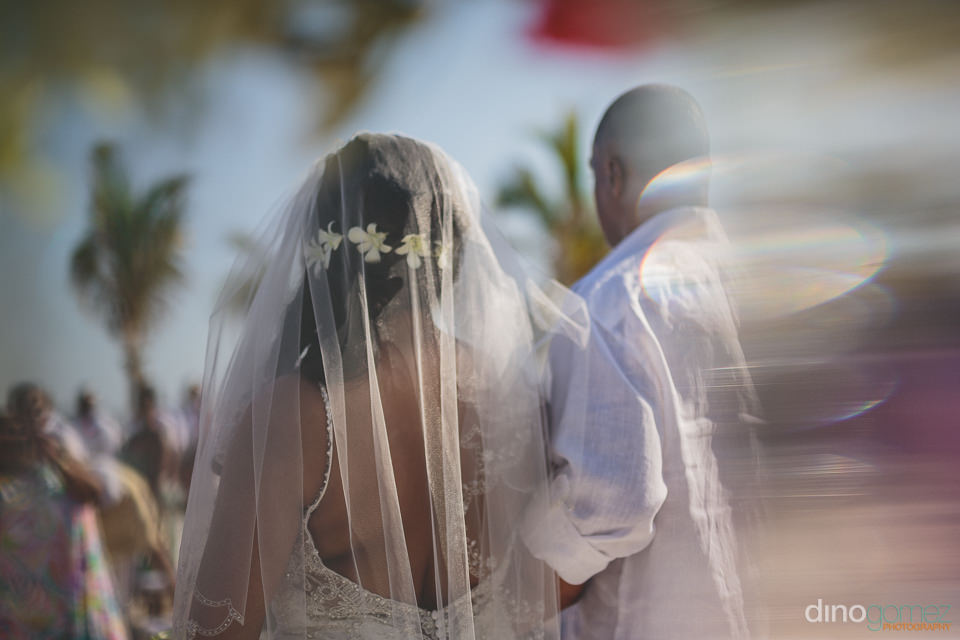 father walks bride down aisle at tropical mexico wedding in cabo