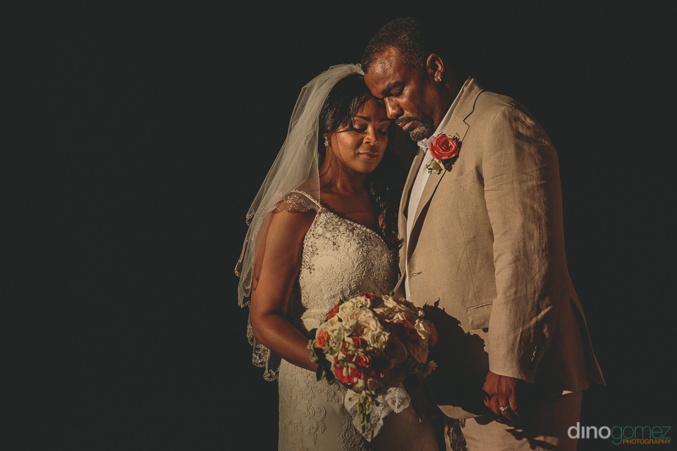 classy low light wedding photo of newlyweds in los cabos by dino