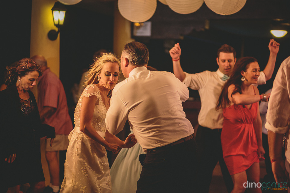 bride and groom dancing with their wedding guests at flora farms