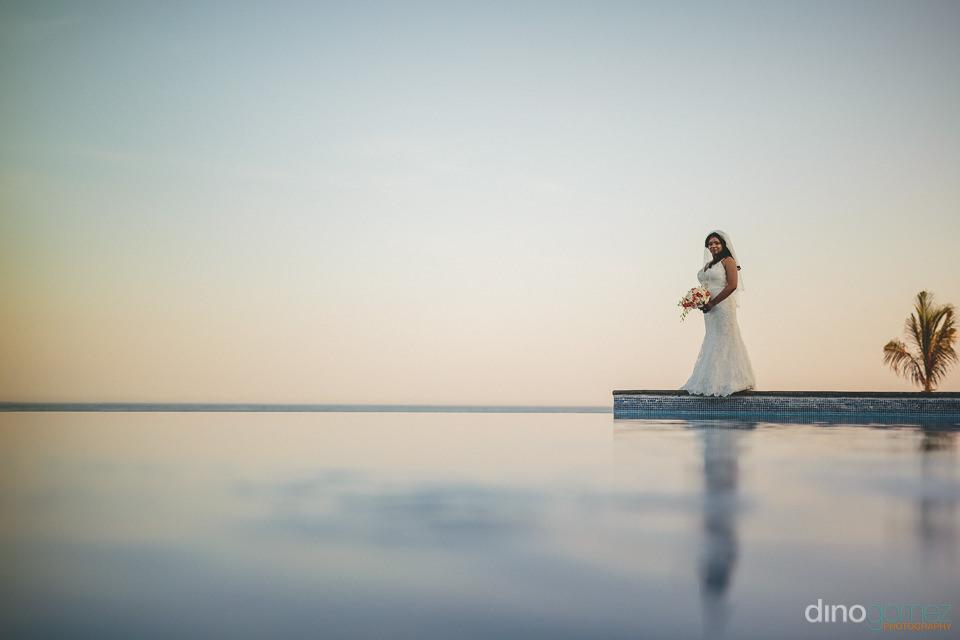 bride wedding photo walking on water sky floating infinity pool