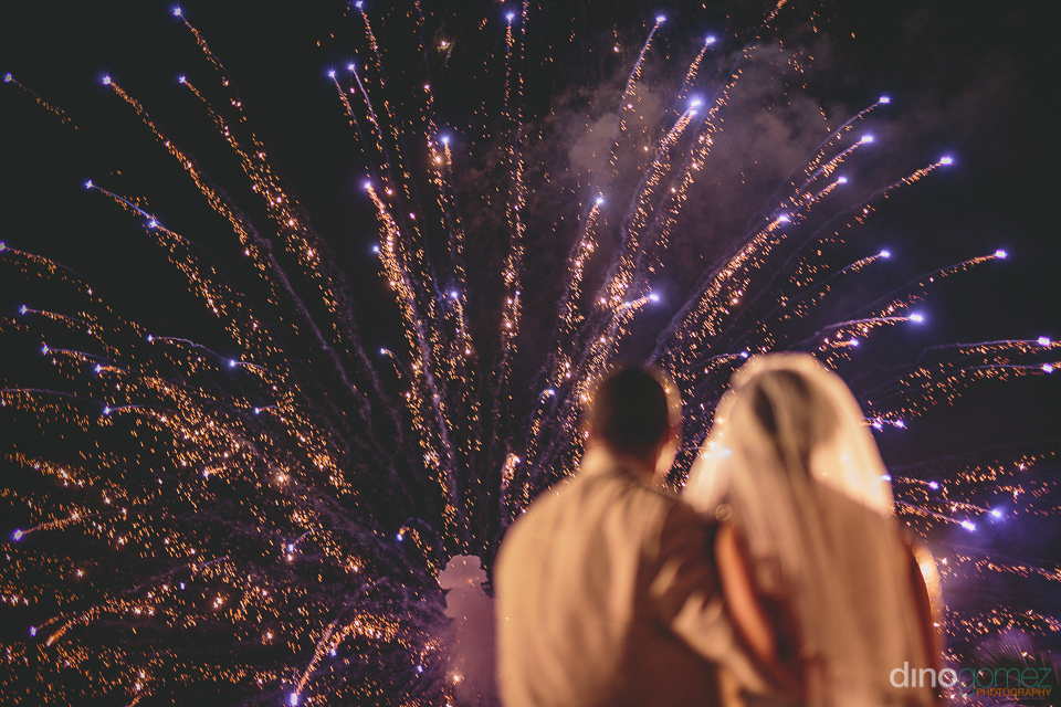 purple fireworks explode in cabo night sky for destination weddi