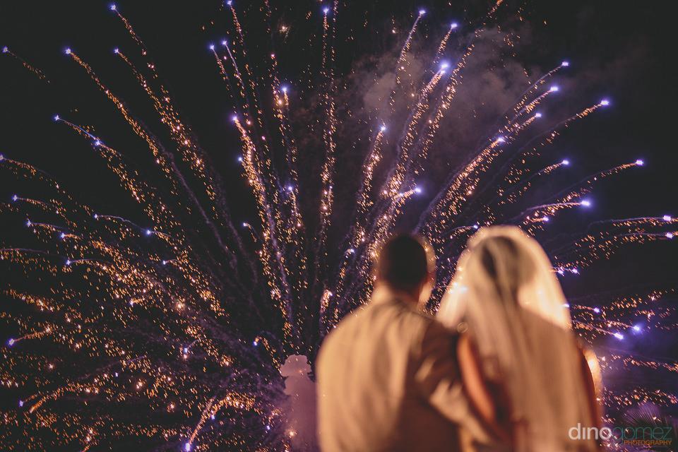 purple fireworks explode in cabo night sky for destination weddi