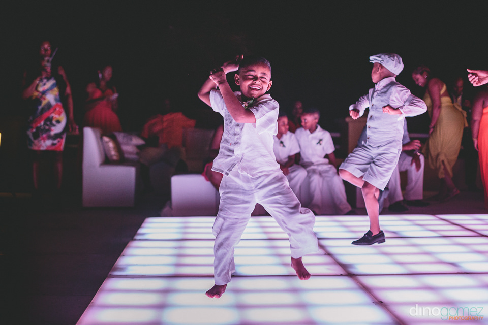 young boy dances happily at wedding reception
