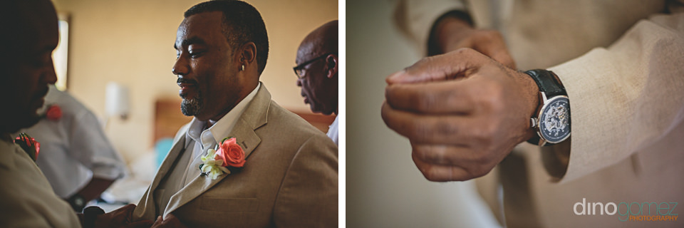 groom wears classy wristwatch and pink boutonniere