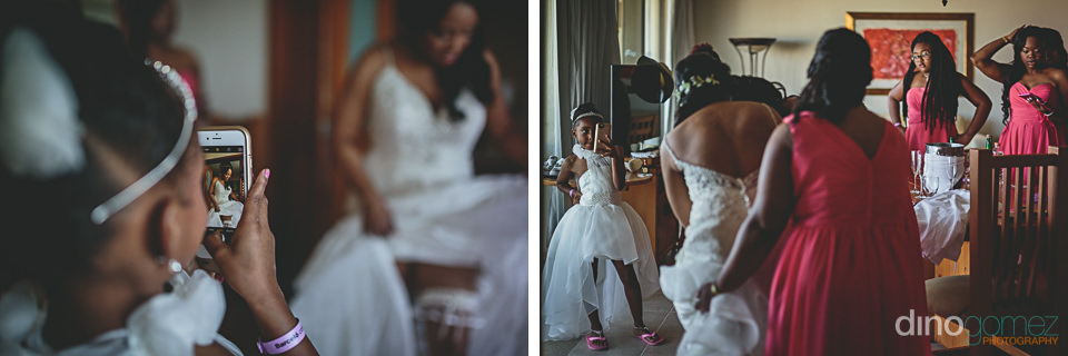 bridesmaids help the bride prepare for the wedding photos by din
