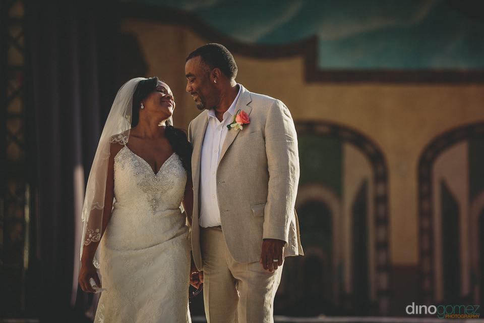 bride in dress groom in suit destination wedding in cabo san luc