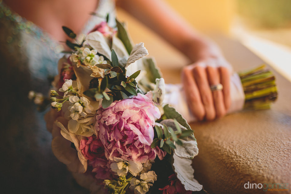 earthy natural bouquet flowers match wedding dress