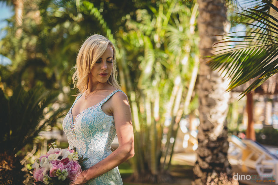 bride at tropical destination wedding in mexico