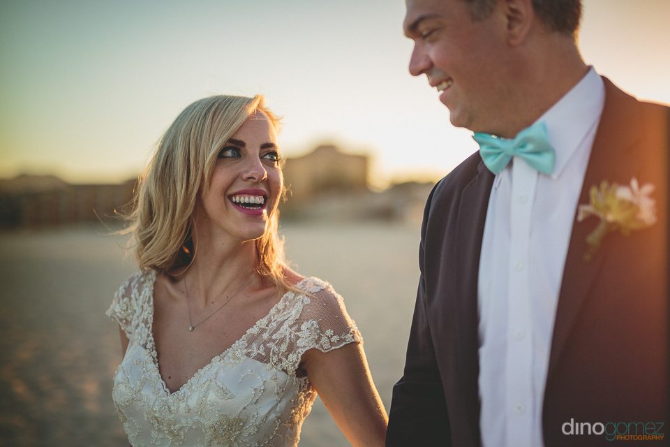 destination wedding on the beach with photos by dino gomez in ca