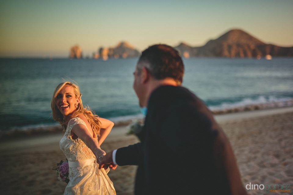 spring wedding on the beach in los cabos with photos by dino gom