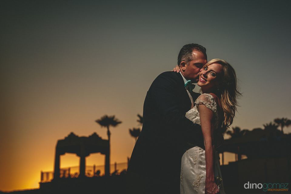 sunset silhouette photo by dino gomez of newlyweds from canada a