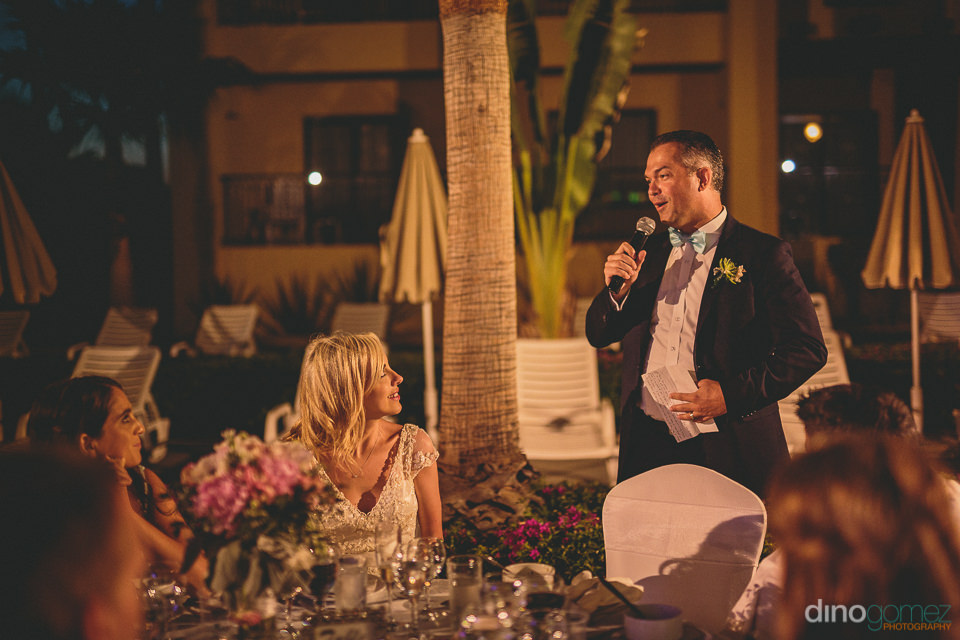 groom gives speech at wedding reception