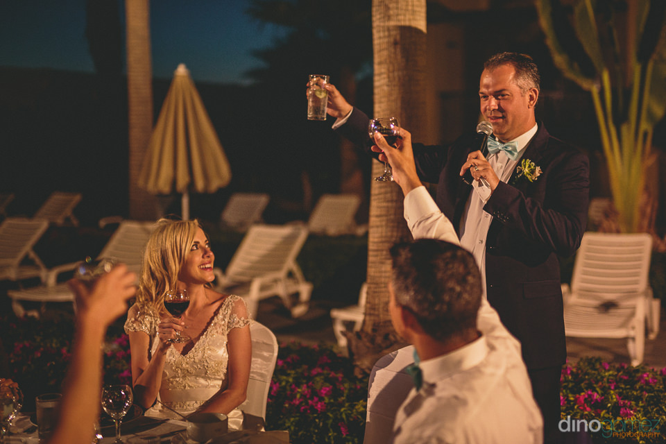 groom gives a toast to his wedding guests friends and family
