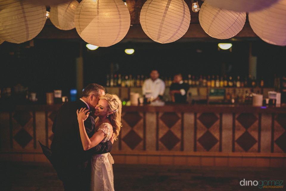 newlyweds dance together at flora farms wedding in los cabos