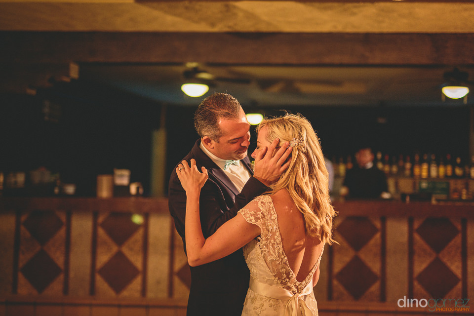 loving newlyweds dance romantically during wedding reception