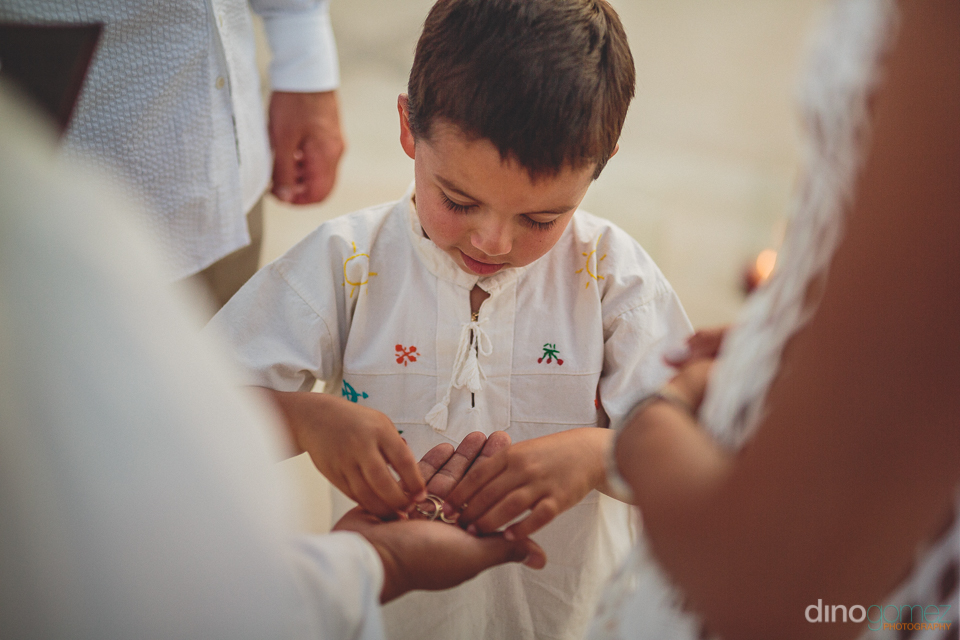 young boy presents ring at all inclusive destination wedding at