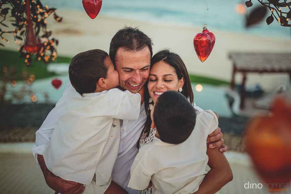 family together in wedding photo by cabo photographer dino gomez