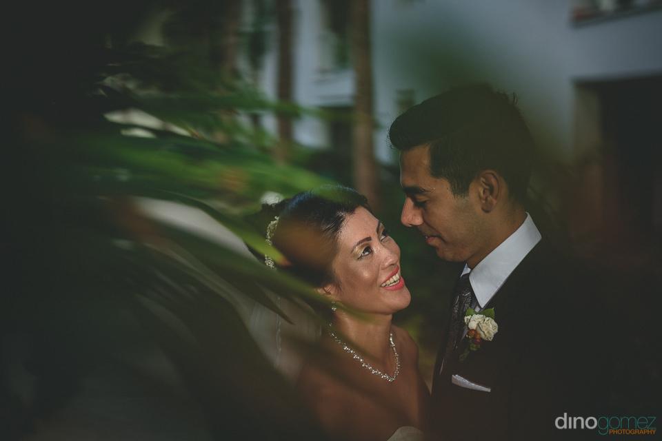 imaginative and creative wedding photo of newlyweds taken throug