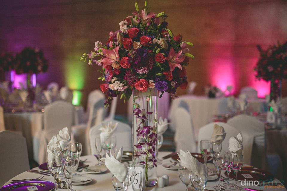 large rose centerpieces on wedding dinner tables at hyatt ziva l