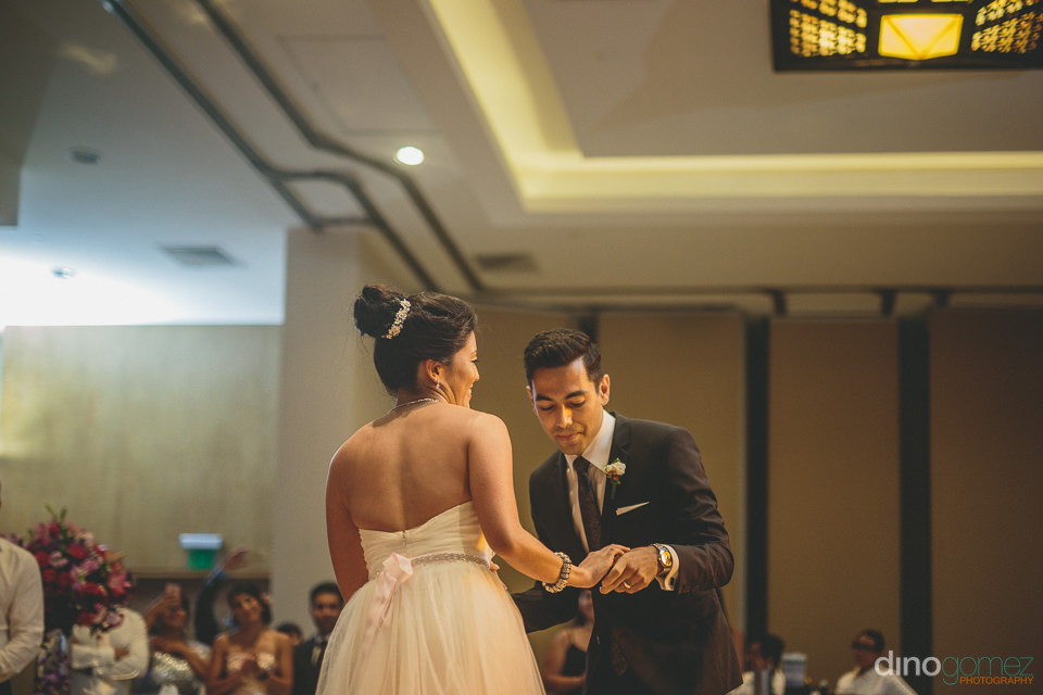 first dance for young newlywed couple at wedding reception at hy