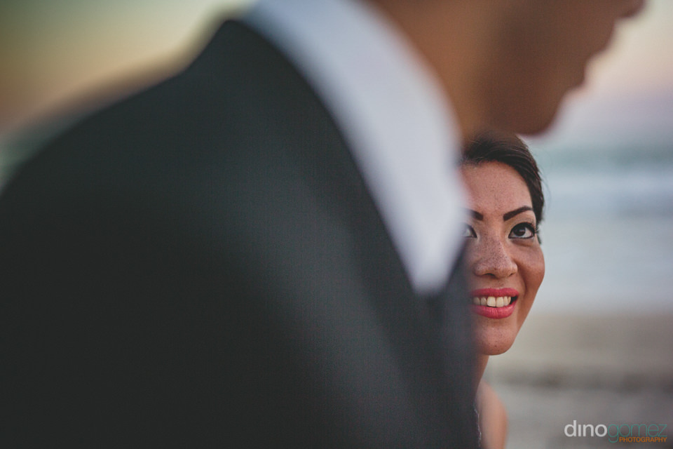bride looks affectionately at groom as they walk together on the