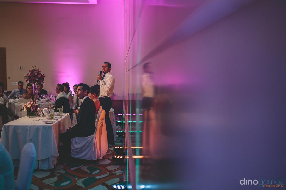 best man gives speech at wedding at hyatt ziva in los cabos mexi