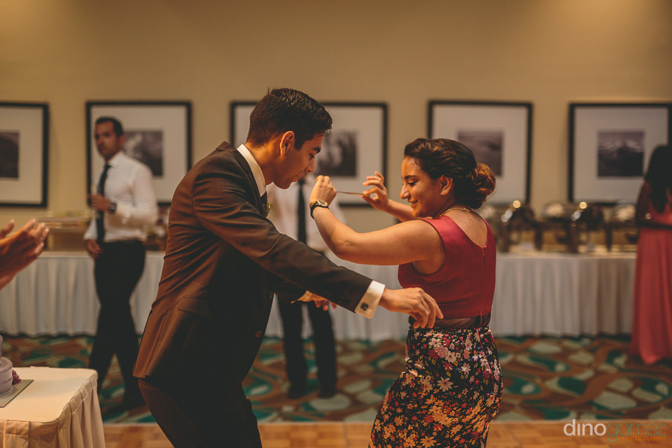 groom dances with wedding guests in photo by mexico photographer