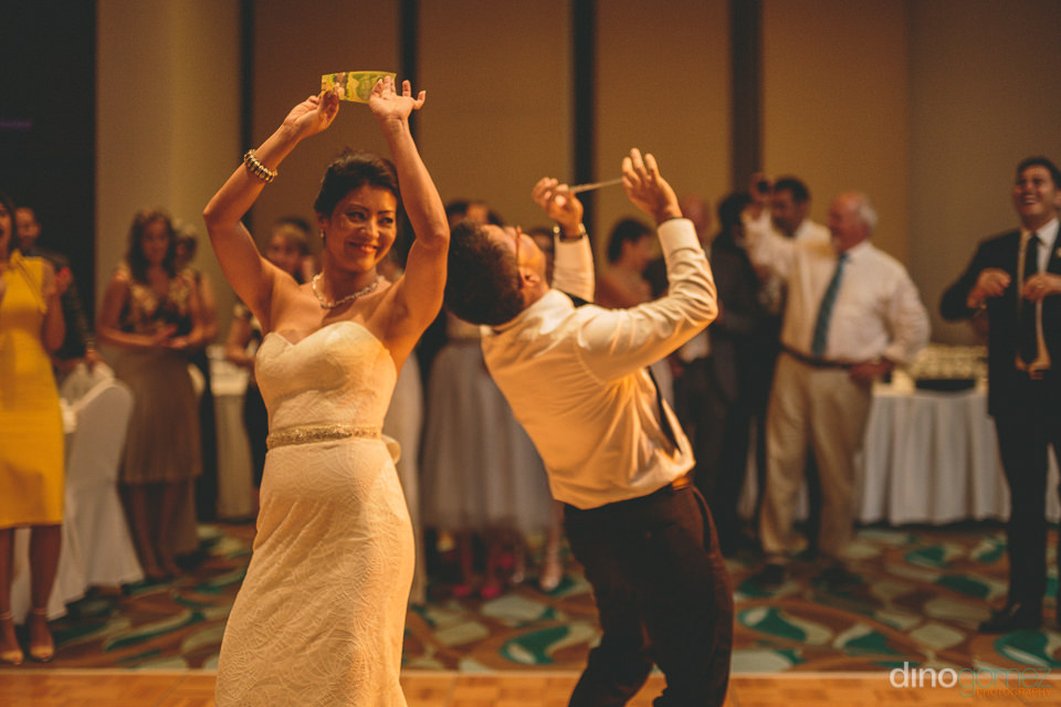 bride dancing with guests during wedding reception in photo by c