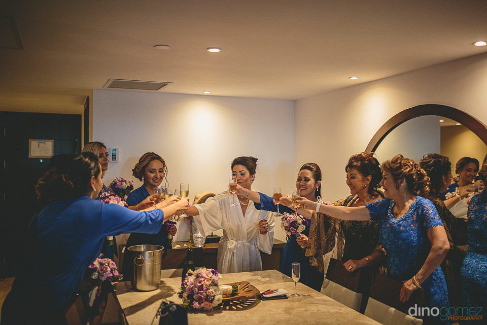 bride bridesmaids toast champagne before wedding at all-inclusiv