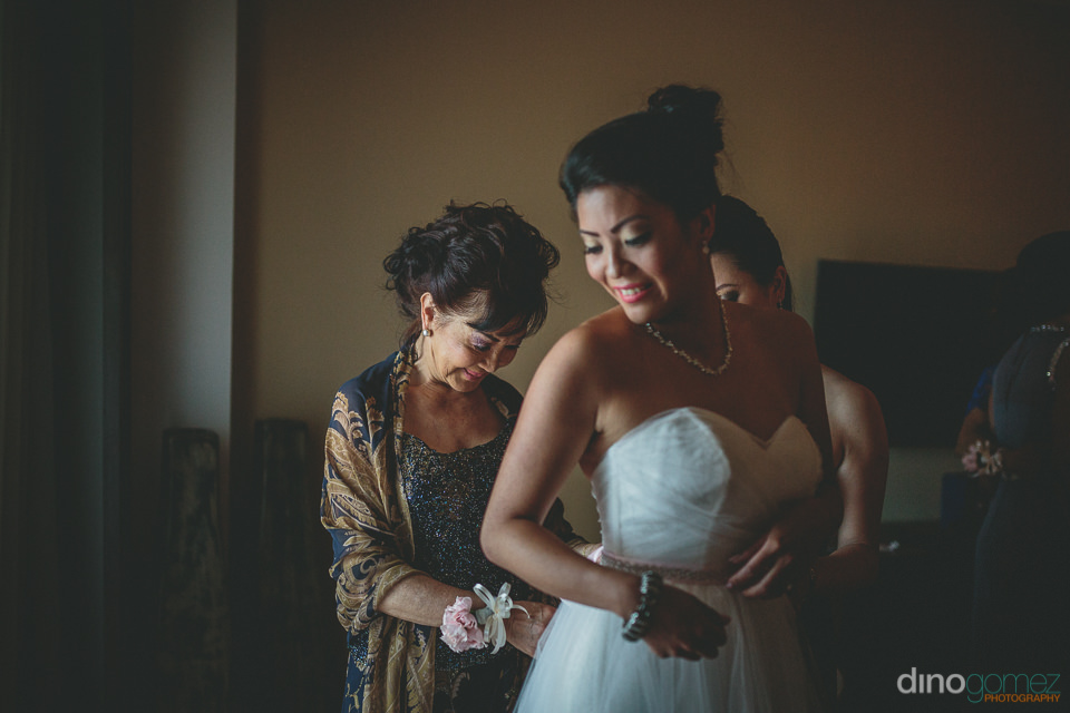 bride and mother together before wedding in los cabos mexico at