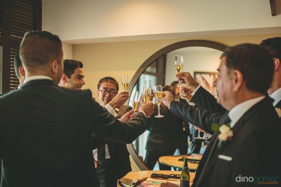 groomsmen champagne toast before wedding photo by cabos best wed