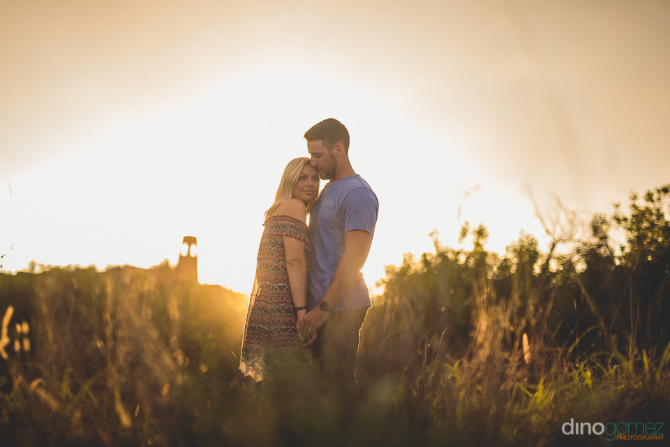 artistic sunset honeymoon photo of young newlyweds in forest par