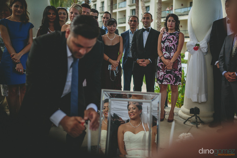 bride sitting at wedding altar reflection in mirror artistic wed
