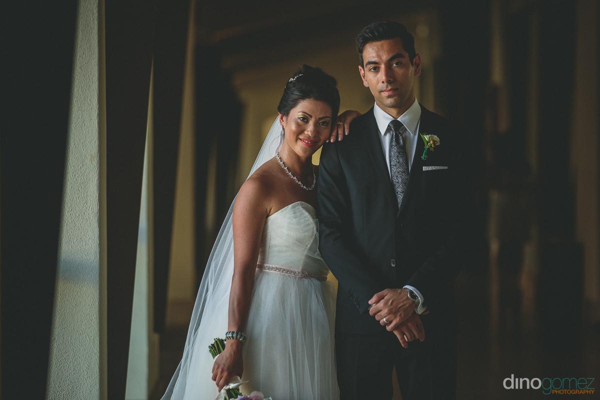 fancy elegant wedding photo of bride and groom together on weddi