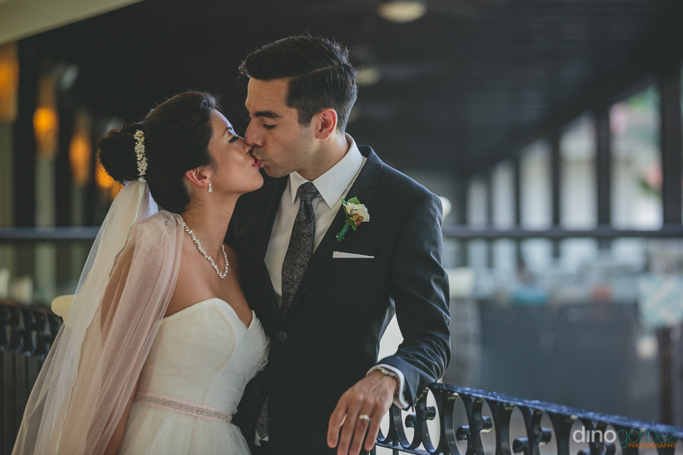 good-looking newlyweds kiss during photo session with best cabo