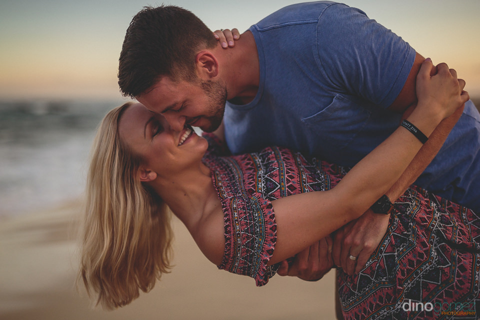 young couple dance on beach at sunset in san jose del cabo cabo