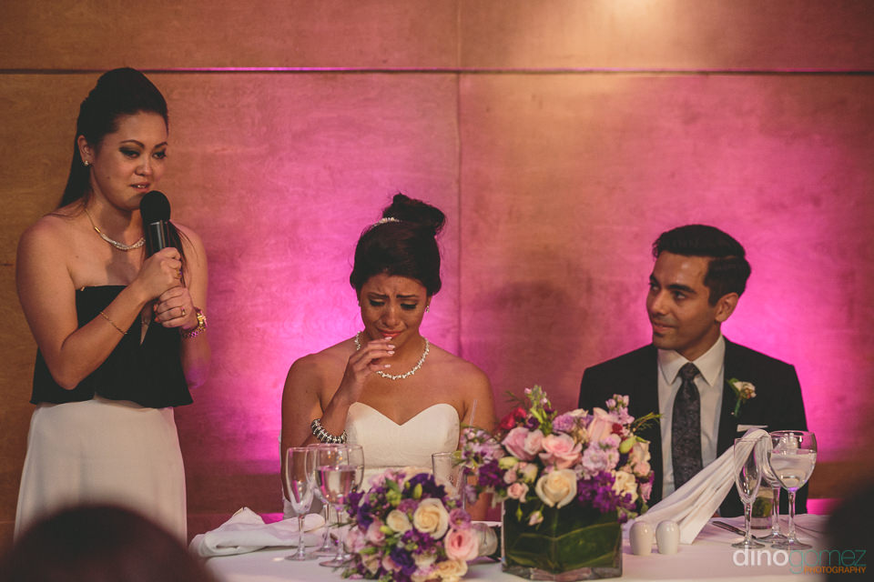 bride cries tears of joy at dinner as sister gives heartfelt spe