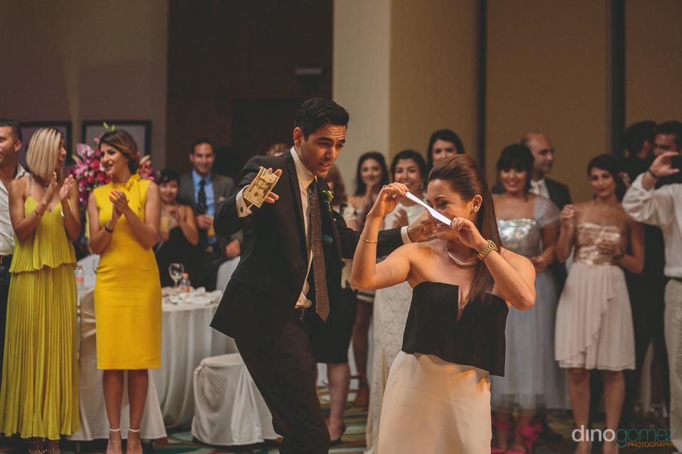 groom dances in ballroom of hyatt ziva los cabos at destination