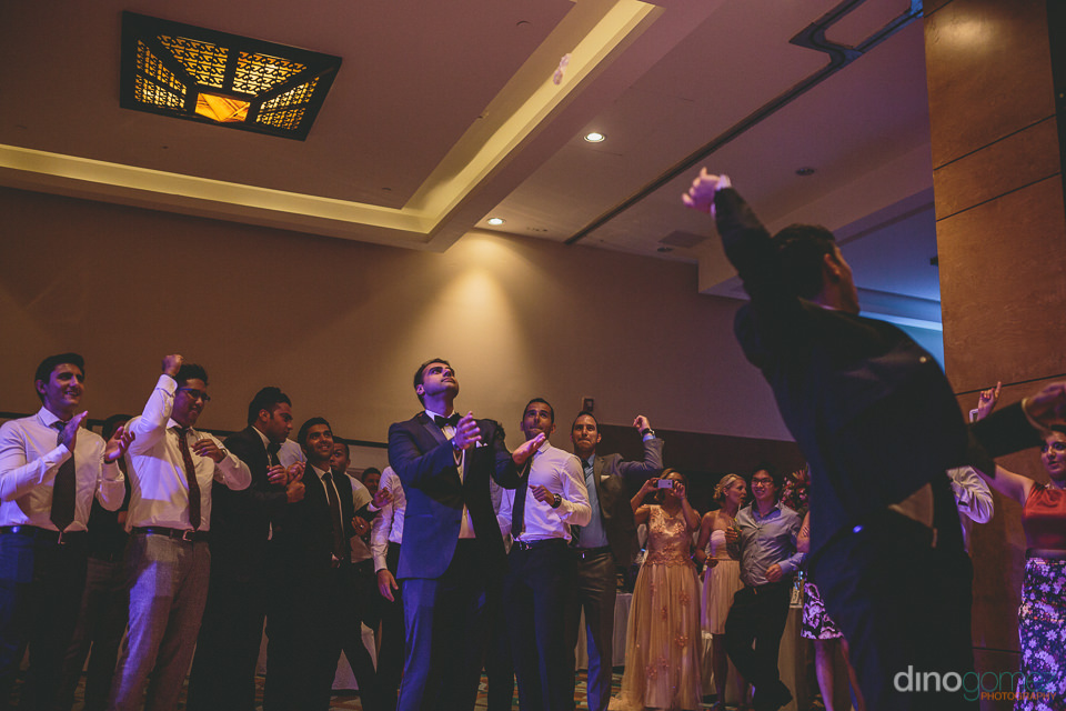 garter toss at wedding in cabo san lucas mexico photographed by