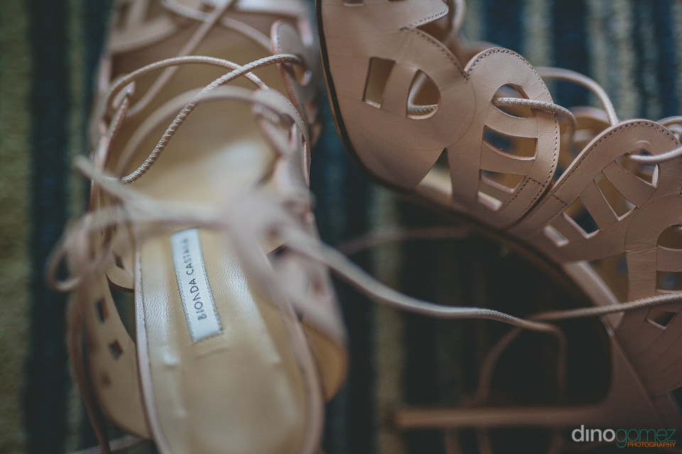 complex closeup photo of brides shoes by cabos best photographer