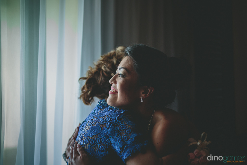 mother hugs daughter before she gets married in destination wedd