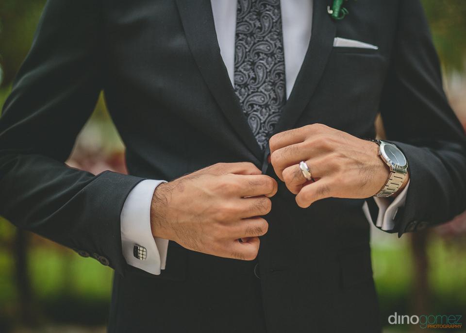 dapper well dressed groom at luxury destination wedding in los c