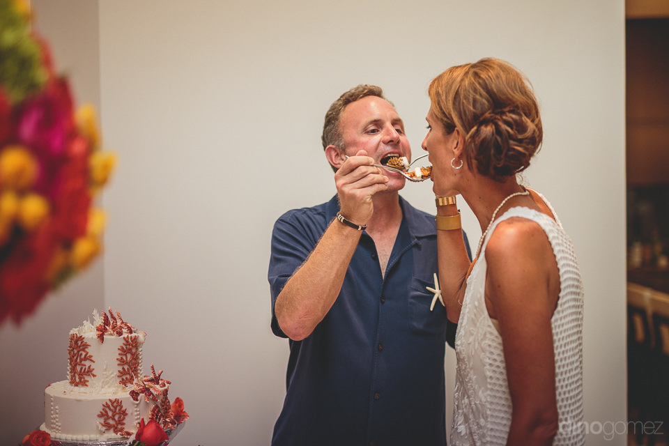 bride and groom eat wedding cake in classy photo by dino gomez