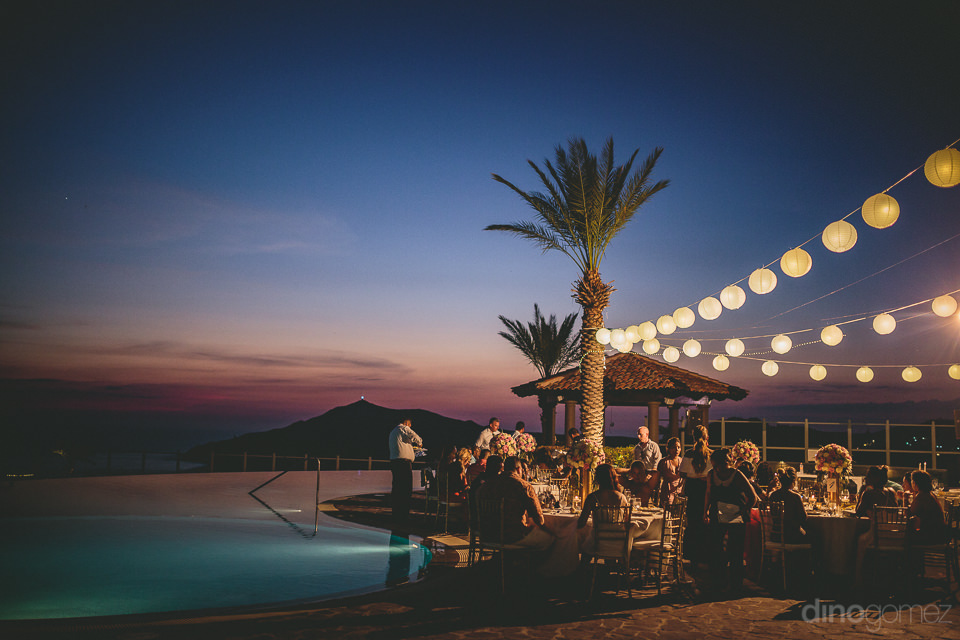sunset on pacific beach in cabo view of wedding reception from p