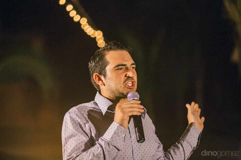 guest speaks into microphone and makes speech during wedding rec