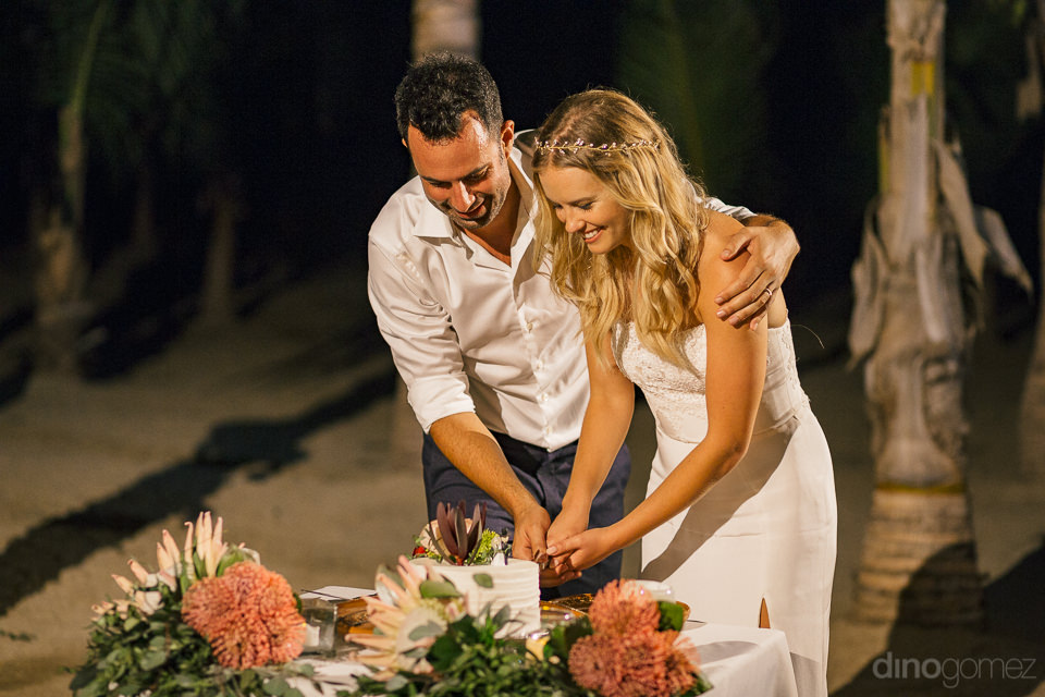 newlyweds cut cake in magical town of todos santos