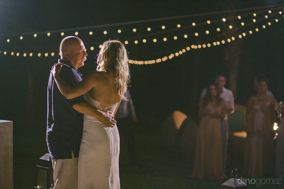 daughter and father together at her wedding reception