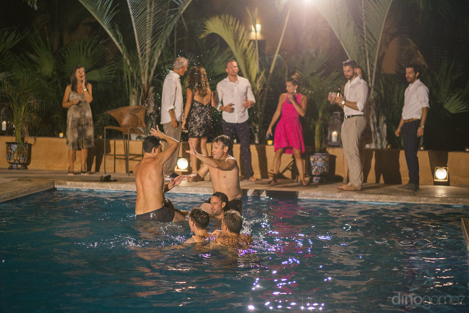 guests swim and play in pool at wedding reception near cabo san